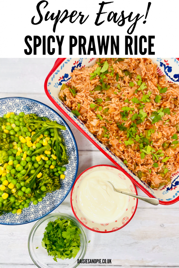 """spicy prawn rice served in a rectangle dish alongside bowl of broccoli, peas and sweetcorn, bowl of natural yogurt and bowl of chopped coriander. Text overlay reads """"super easy spicy prawn rice"""""""