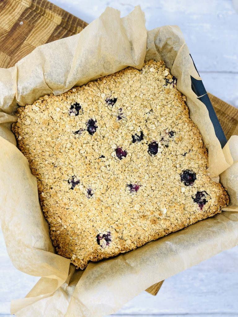 flapjacks with blueberries fresh from the oven in a baking tin