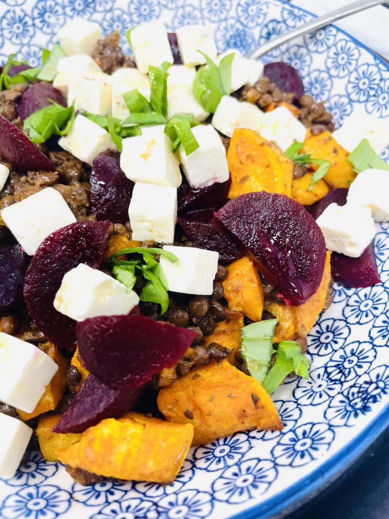 close up image of Puy lentils and feta salad with roasted sweet potatoes and baby beetroot