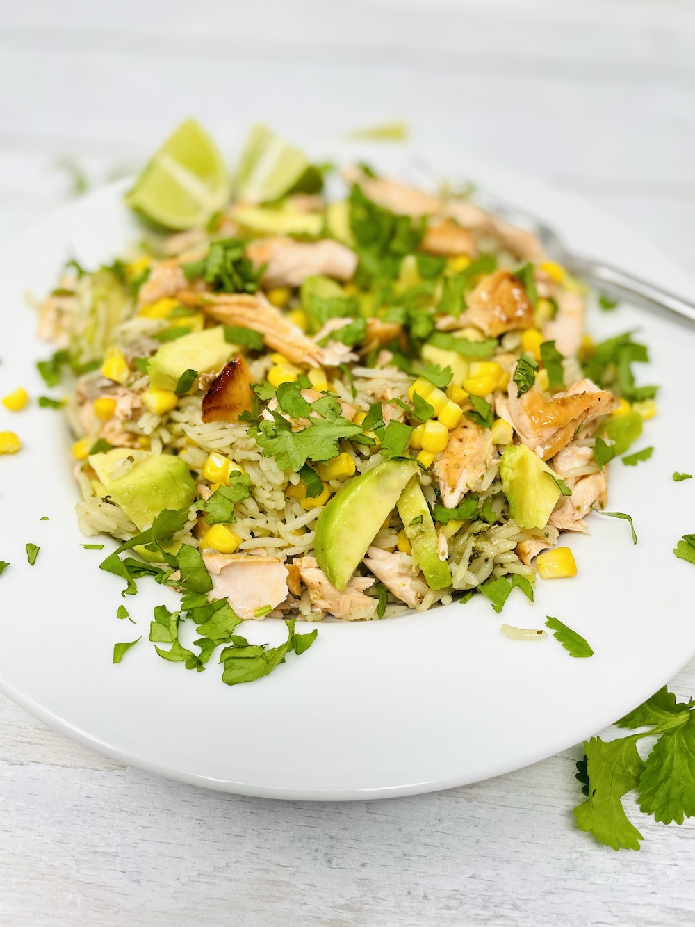salmon and rice - a salmon salad with lime and coriander rice, charred corn and chunks of avocado served with a wedge of lime on the side