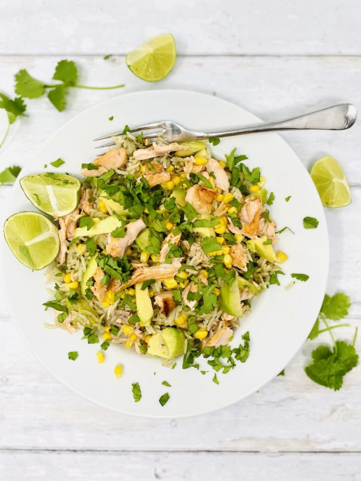 chipotle salmon and rice salad - salmon salad with lime and coriander rice, flaked salmon, avocado chunks, charred corn and lots of lime and chopped coriander