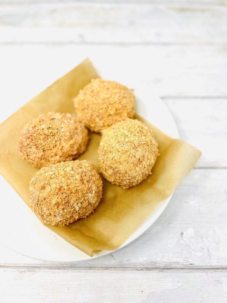 four gluten free scotch eggs ready to deep fry