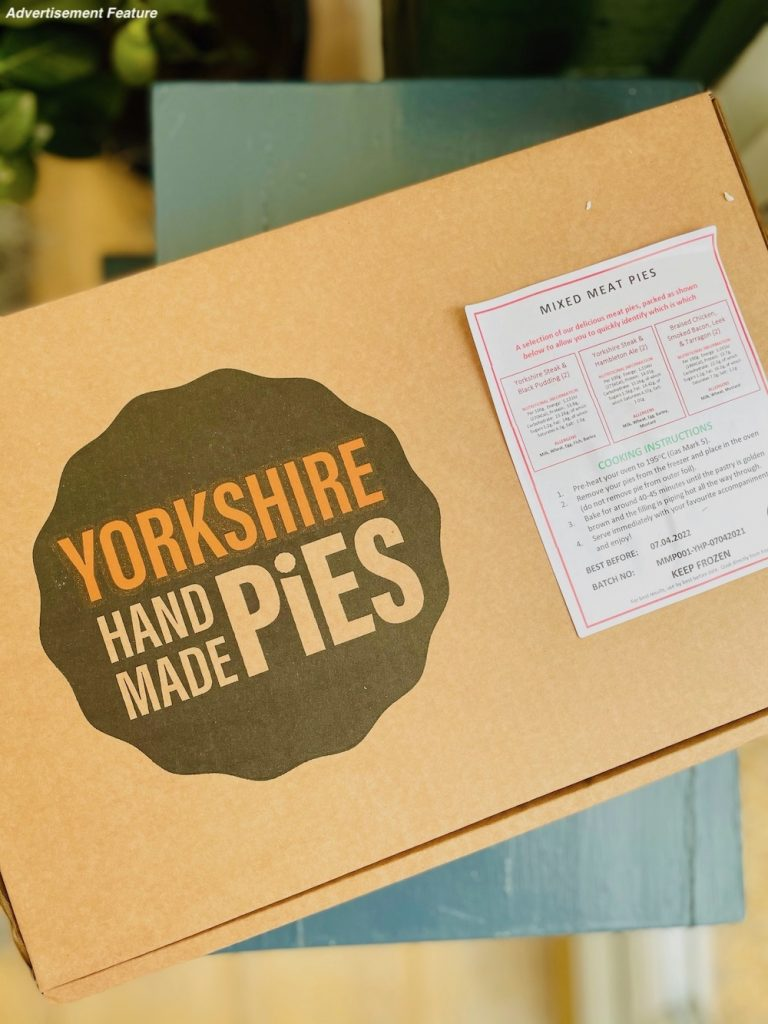 a box of Yorkshire Handmade Pies on a blue wooden stool