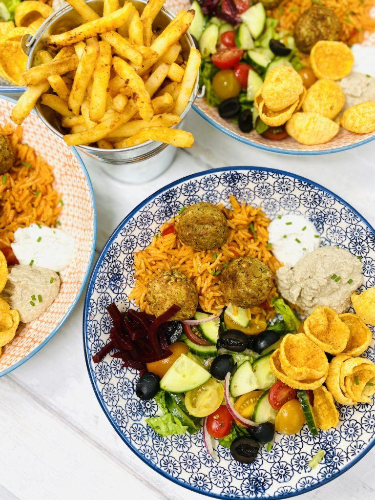 falafel salad with baba ganoush and hummus chips