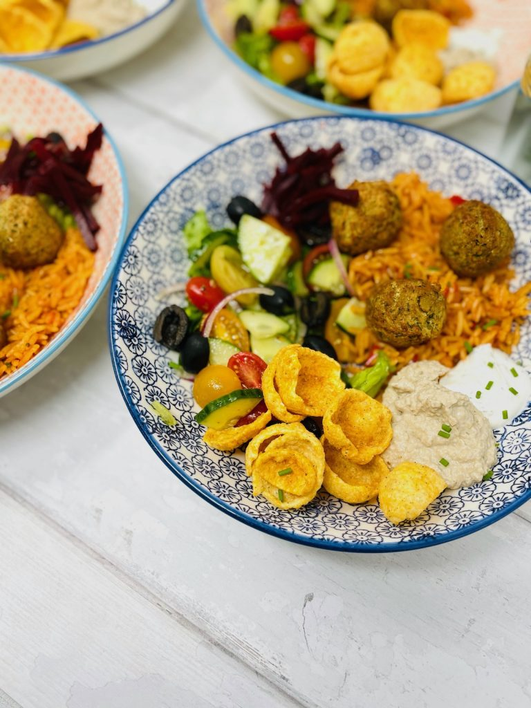 Cauldron falafel served with tomato rice and salad with bucket of fries