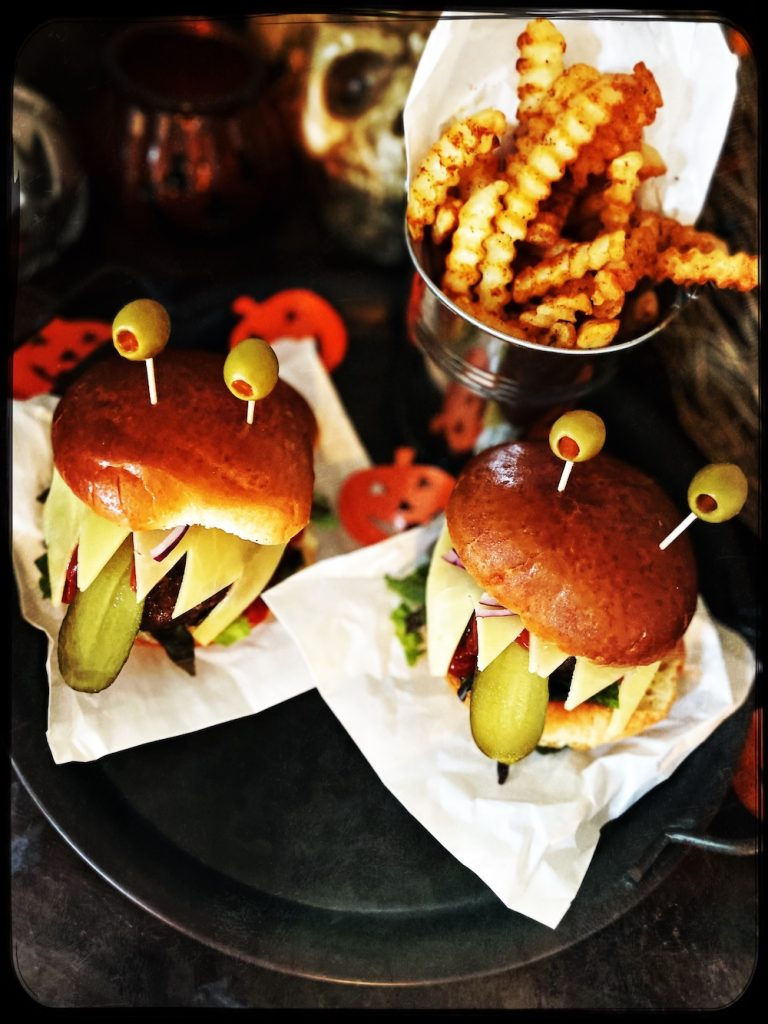 halloween burgers made to look like monster faces with googly eyes
