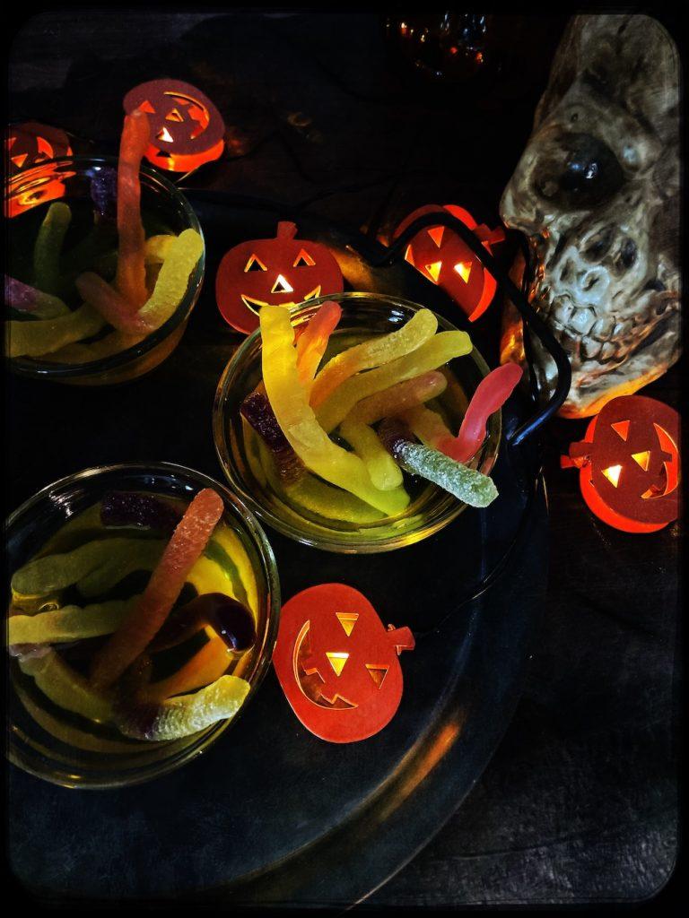 halloween jelly - wormy jelly pots on a tray with jack o lantern fairy lights