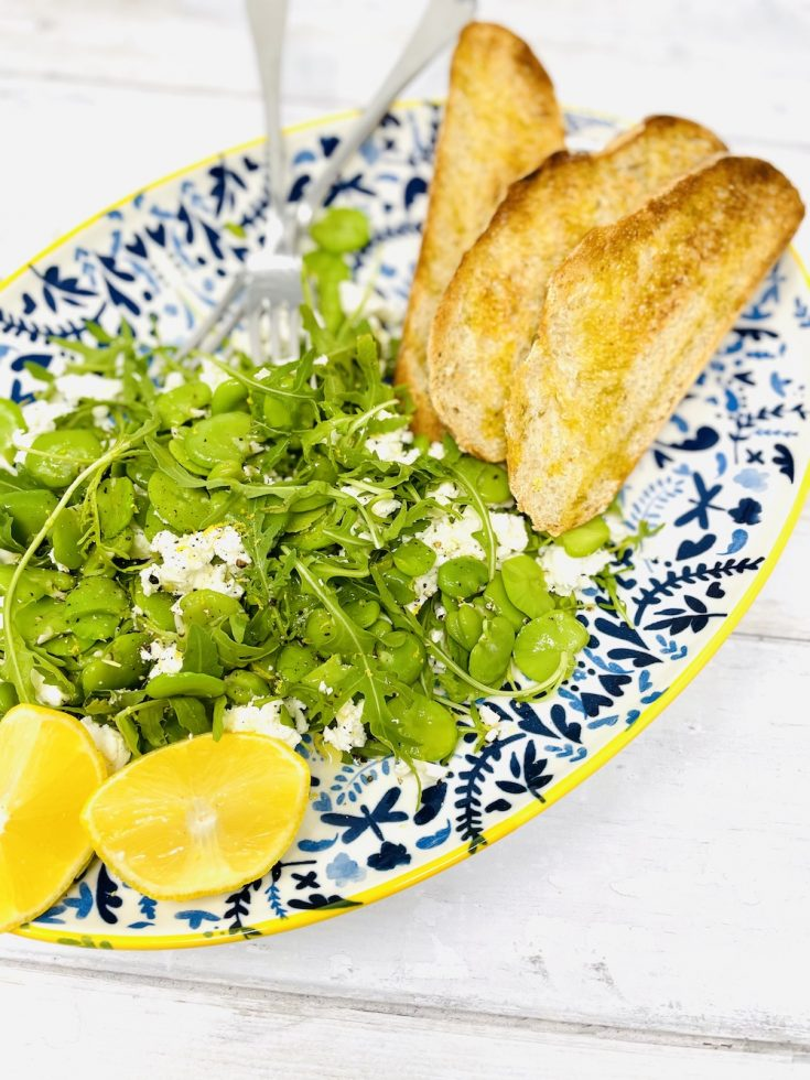 broad bean salad with feta cheese and rocket served with garlicky bruschetta