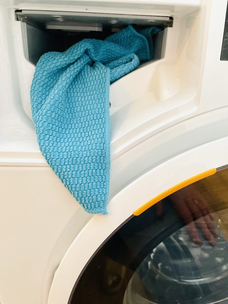 how to clean inside the washing machine drawer space