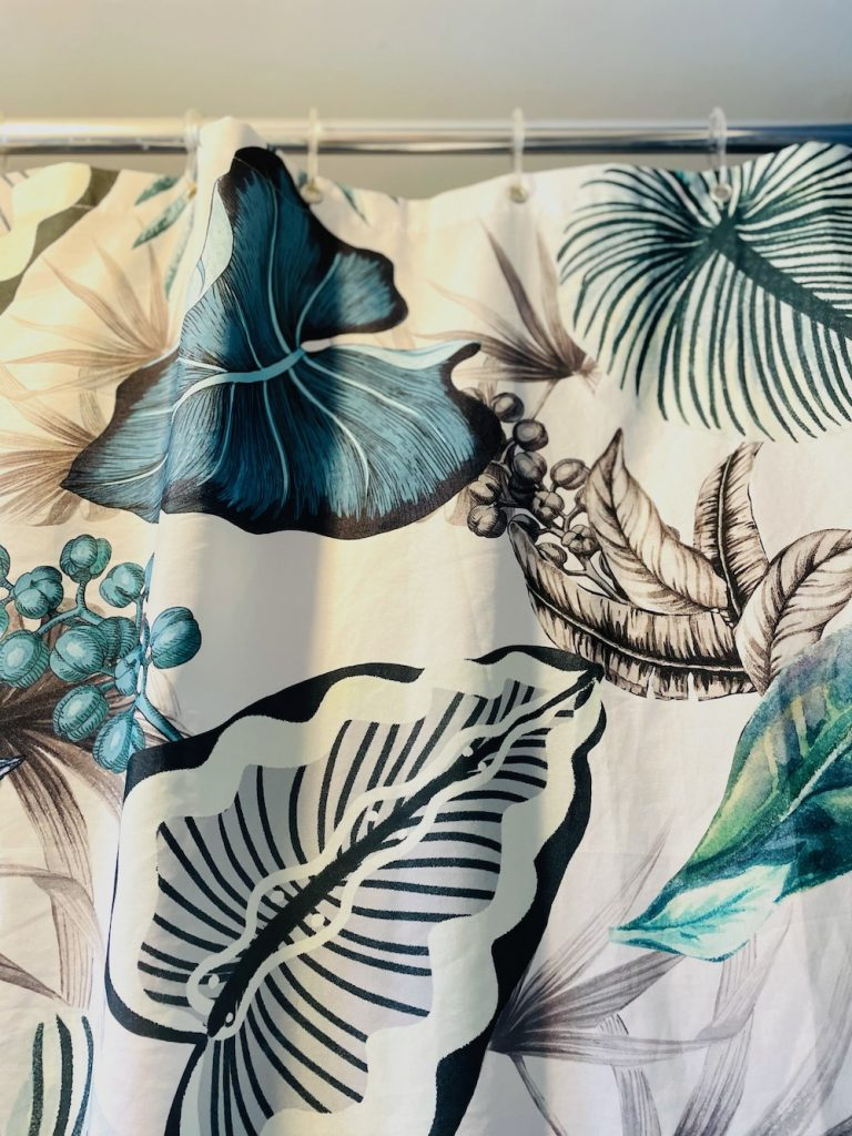 Art Deco shower curtain in blue and white floral patterns