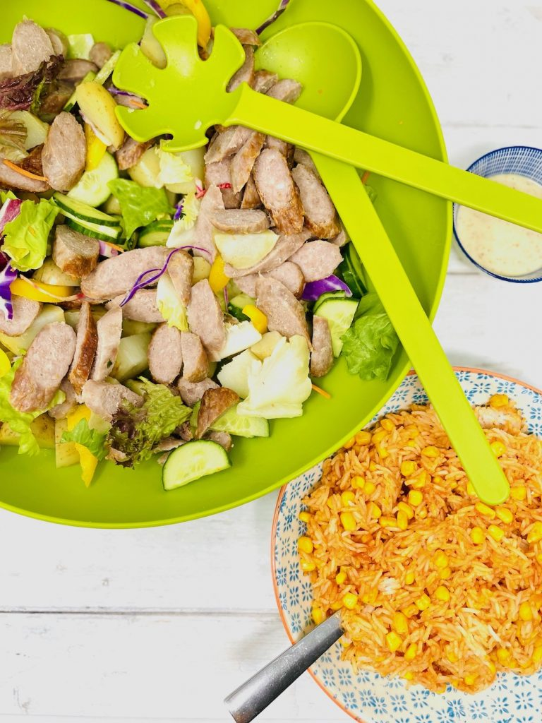 sausage salad with new potatoes, salad leaves, cucumber and pepper slices