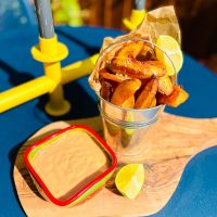 sriracha mayo served with bucket of homemade potato wedges for dunking
