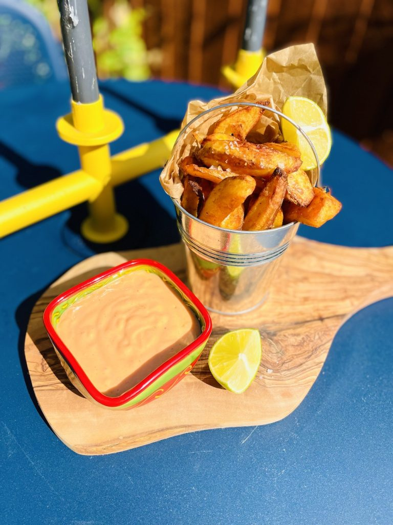 sriracha mayo served with homemade potato wedges for dunking.