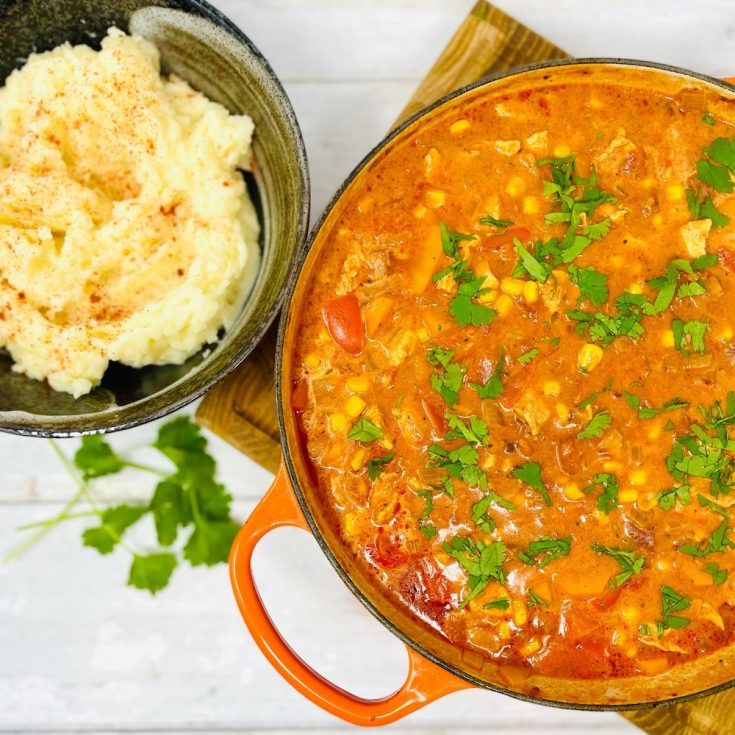Mexican chicken stew served with a bowl of paprika mashed potatoes