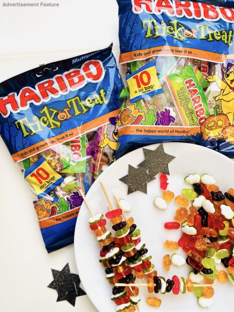 Making Halloween candy witch wands with Haribo halloween sweets, kebab sticks and black stars