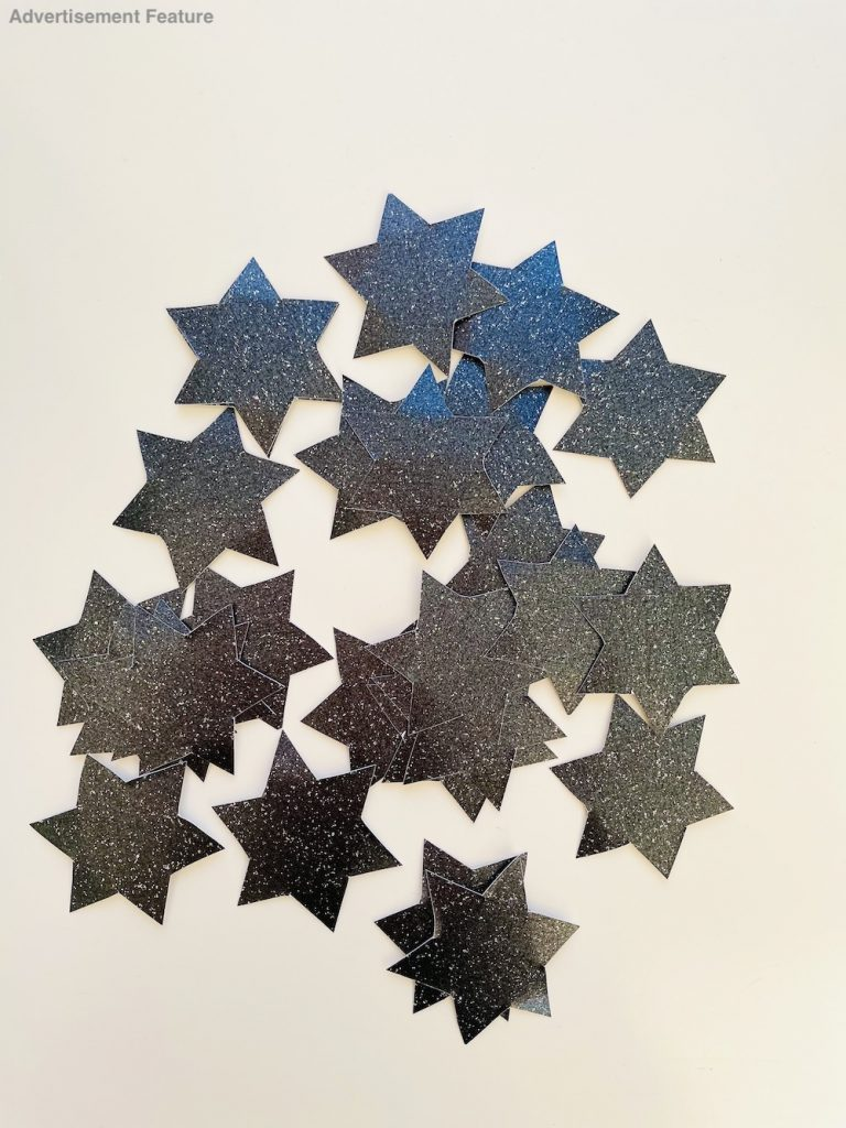 stars cut out from sparkly black cardboard