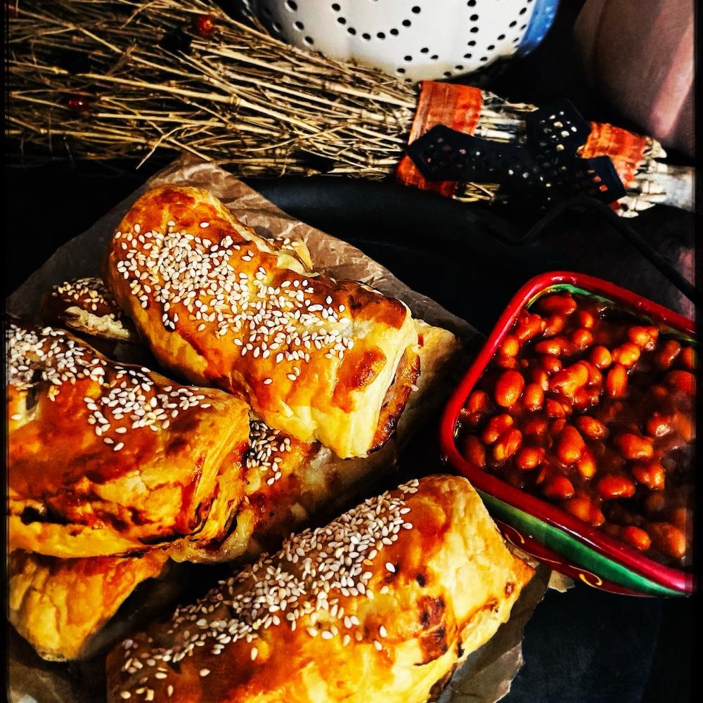 chilli sausage rolls served alongside BBQ baked beans
