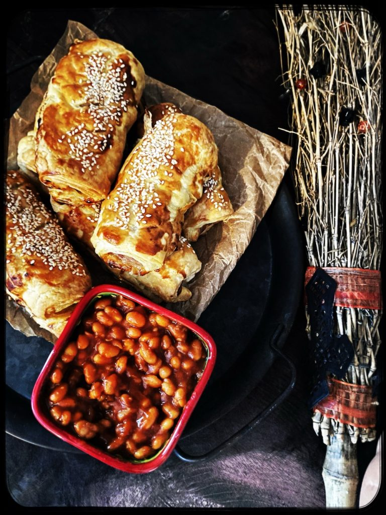 platter of chilli sausage rolls served with BBQ baked beans