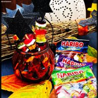 Halloween Candy Witch Wands made with Haribo trick or treat sweets. All stored in a pumpkin jar