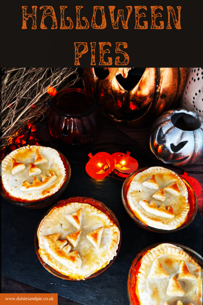 """halloween pies with jack o lantern faces on a black slate serving platter. Text overlay reads """"halloween pies"""""""