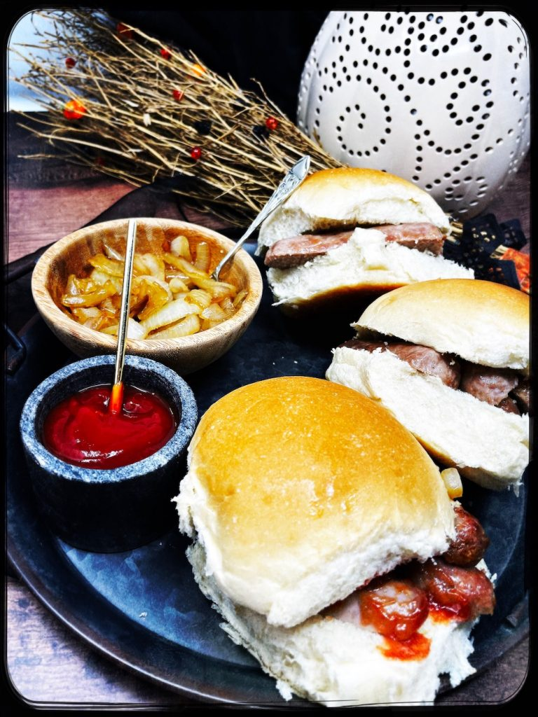 sausage bap with boozy caramelised onions served as Bonfire Night food