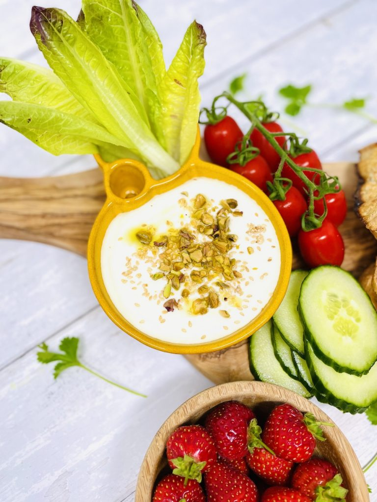 whipped feta dip topped with pistachio nuts and toasted sesame seeds. Served alongside ruby little gem lettuce leaves, cucumber slices, toasted sourdough bread, strawberries and Italian tomatoes