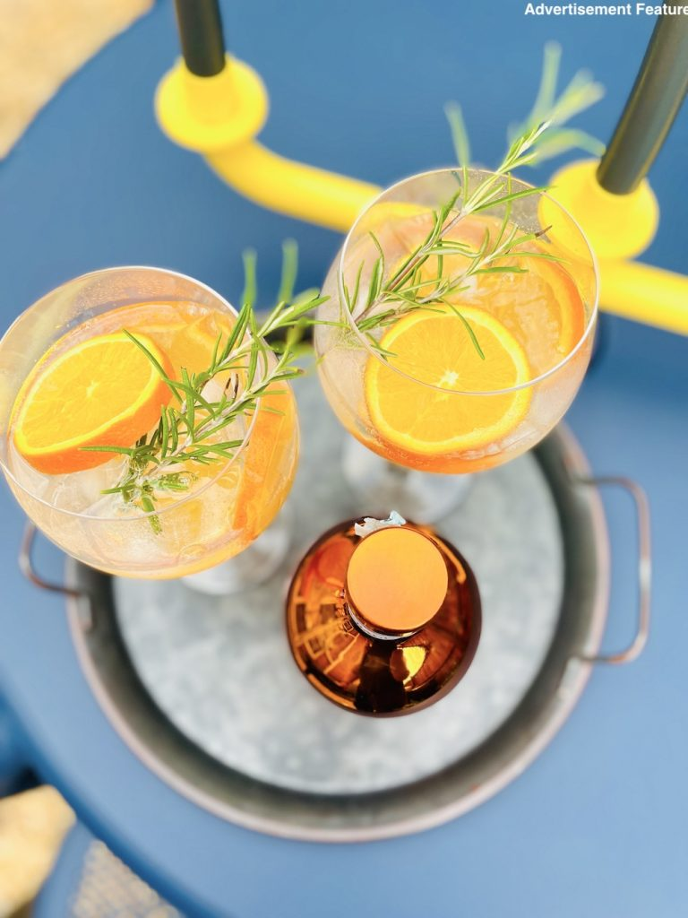 Bottega Gin Bacûr review made into a delicious gin and tonic with oranges and rosemary infused