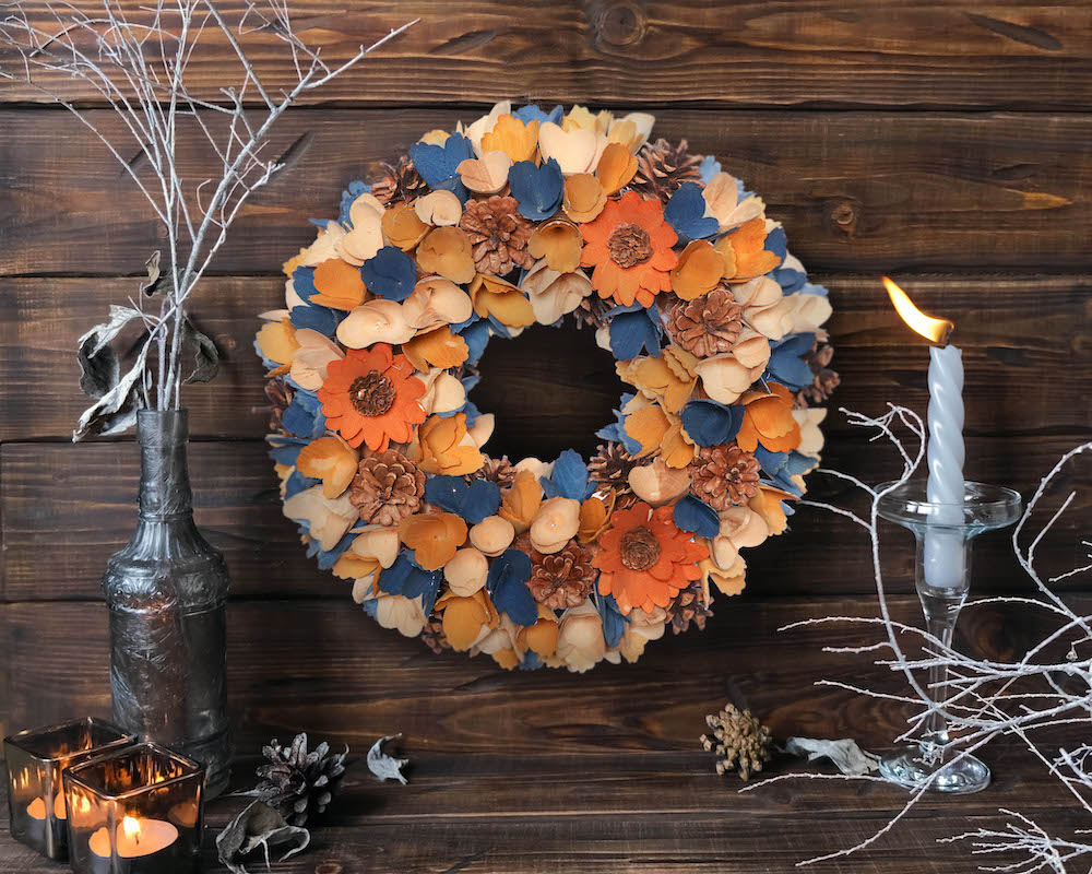 Dibor Halloween wreath decorated with dark blue and orange leaves, flowers and pine cones - from Dibor