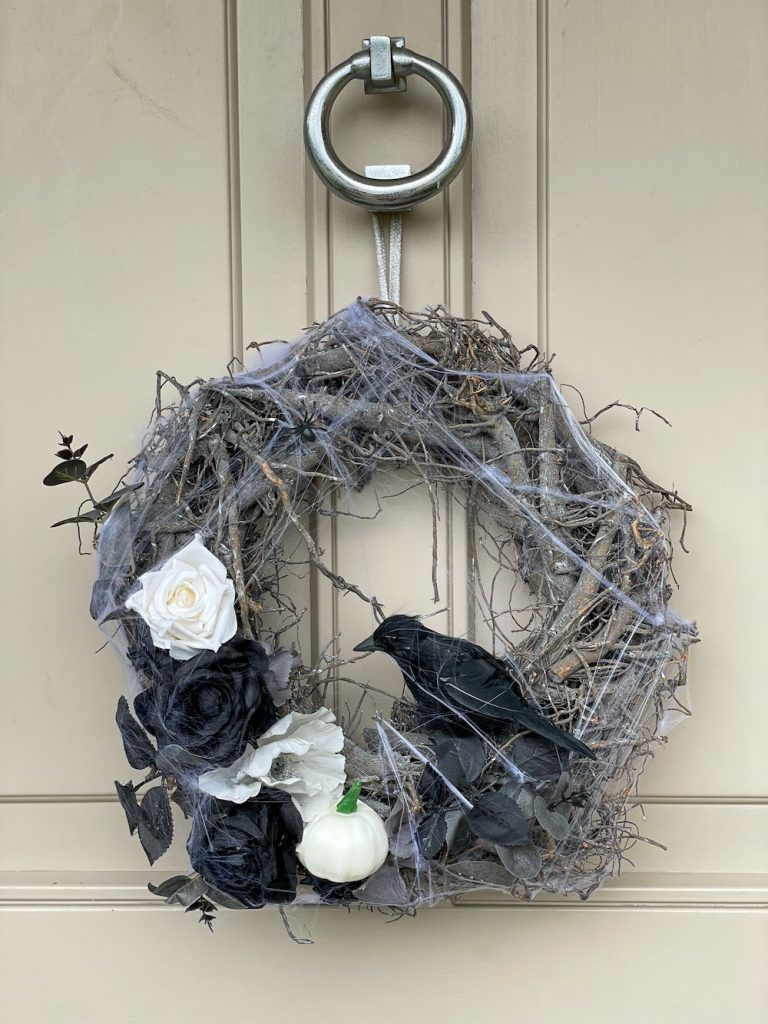 Gothic Halloween Door Wreath with black crow and black and white roses - from Woodland Wreath Company