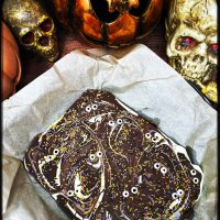 Halloween chocolate bark decorated with edible eyes and Halloween sprinkles