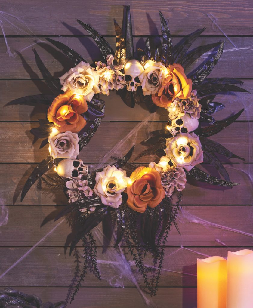 Halloween wreath - gothic style with skulls, orange and white flowers and black leaves from The Range