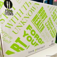 Love Yourself healthy meals delivered - box with green and white packaging
