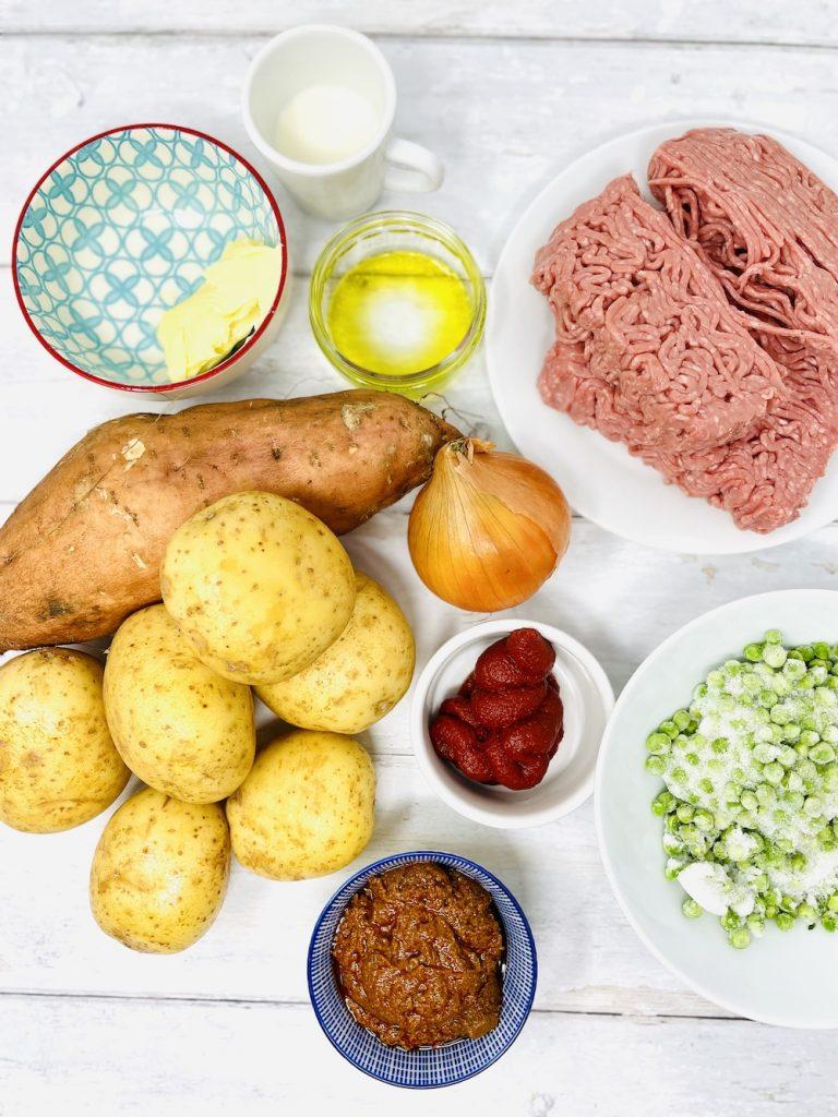keema pie ingredients - minced lamb, white potatoes, sweet potatoe, frozen peas, curry paste, tomato puree, olive oil, butter, milk