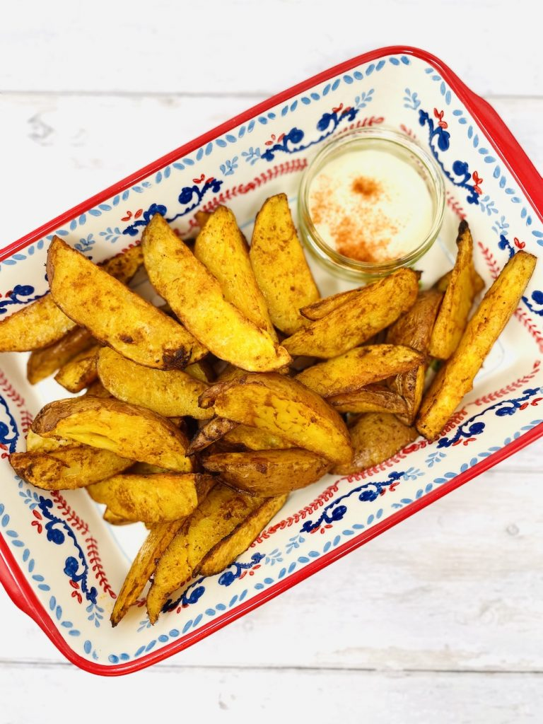 paprika wedges in a serving bowl with flavoured mayonnaise dip